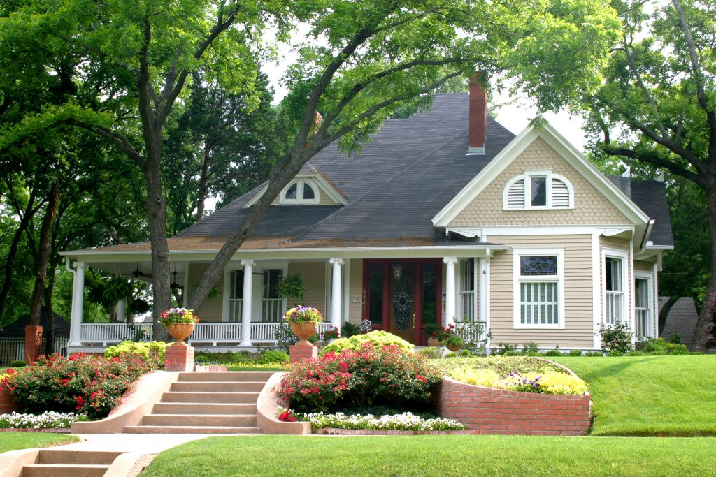 renting vs owning, traditional house, colorful flowers, neighborhood